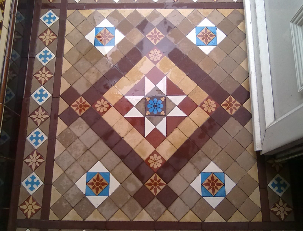 Victorian Tiled Floor Midway through cleaning