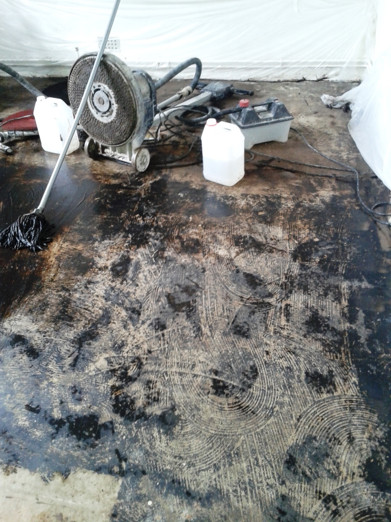 Concrete Floor Bridport Covered in Bitumen before cleaning